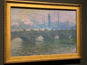 Photo of one of Monet's paintings that shows his observation and reflection of turbulent water