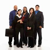 five diverse business team members standing and smiling